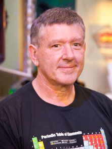 a headshot of man wearing a t-shirt