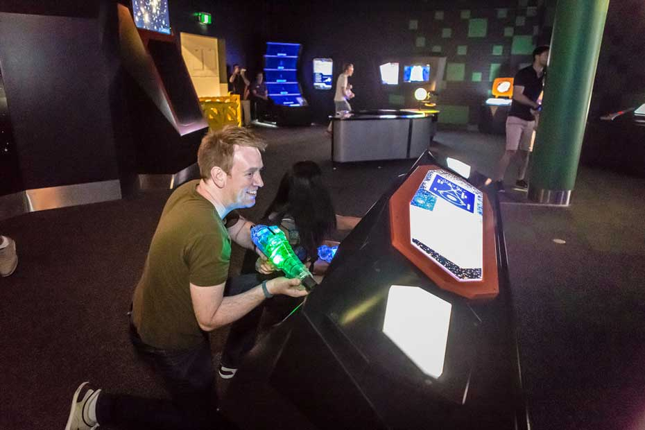 People playing laser tag in the Awesome Earth Gallery