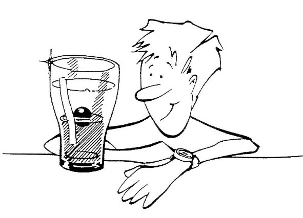 Image of a person with a glass with layers of liquids