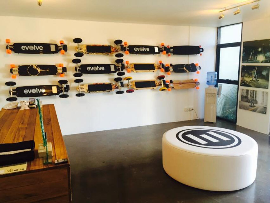 Evolve Skateboards store with range of boards mounted on the wall
