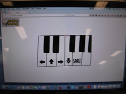 Title: Makey Makey Piano - Description: A laptop screen showing a small part of a piano keyboard