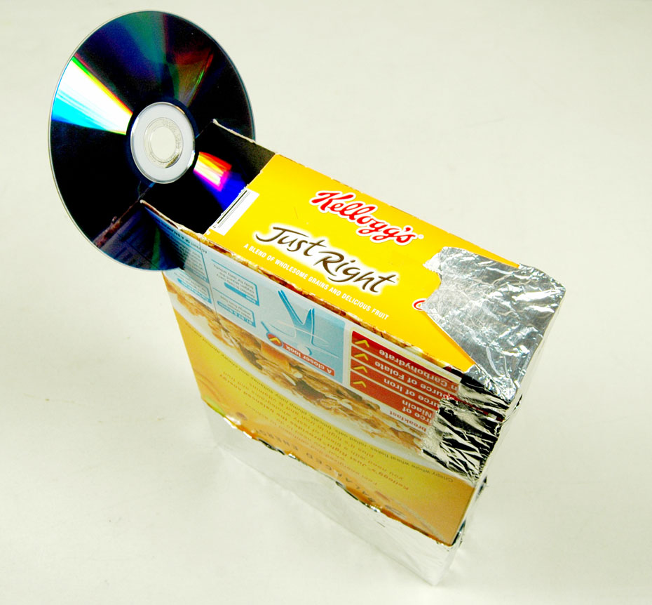A cereal box with a CD inserted into the top left corner.