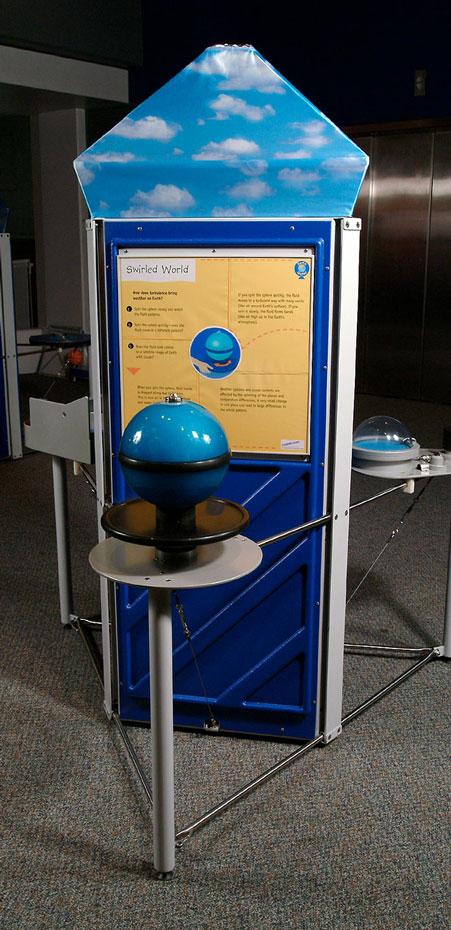 A exhibit with a blue and black sphere at the front and a yellow and blue information panel at the rear.