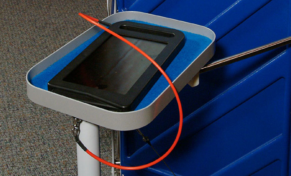 A black framed filter with a red cord attached to a blue and grey tray.