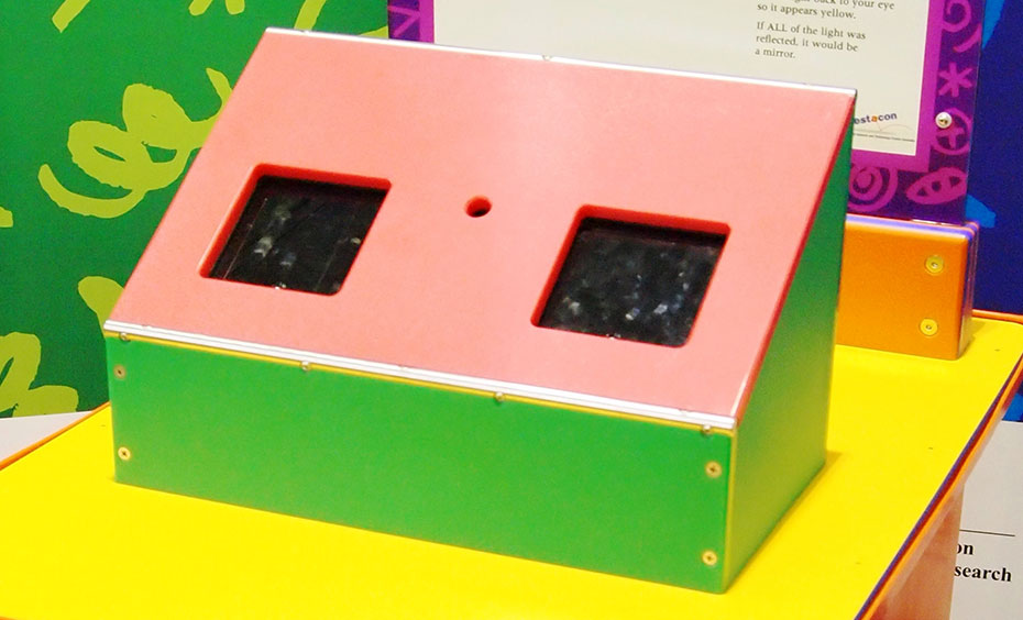 A retangular box with a sloped face and two cut out black areas.