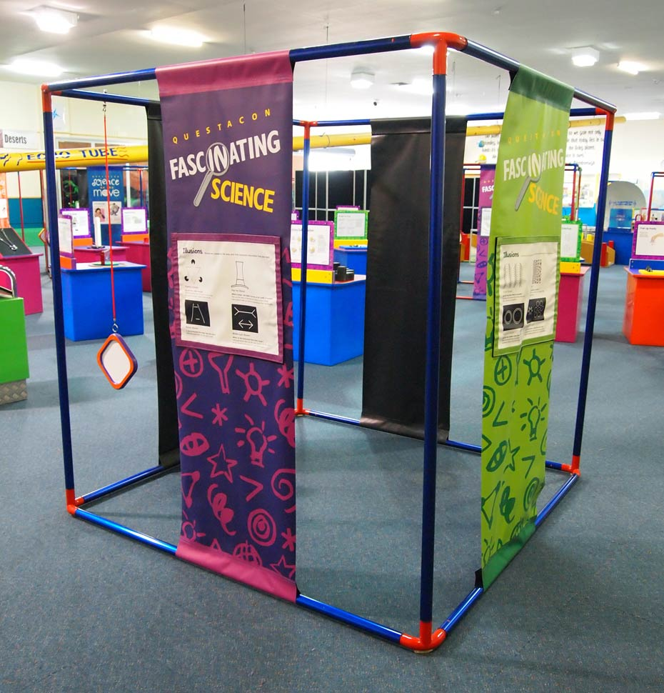 A large blue and red cube frame that has purple and green information banners hanging between top and bottom bars of the cube.