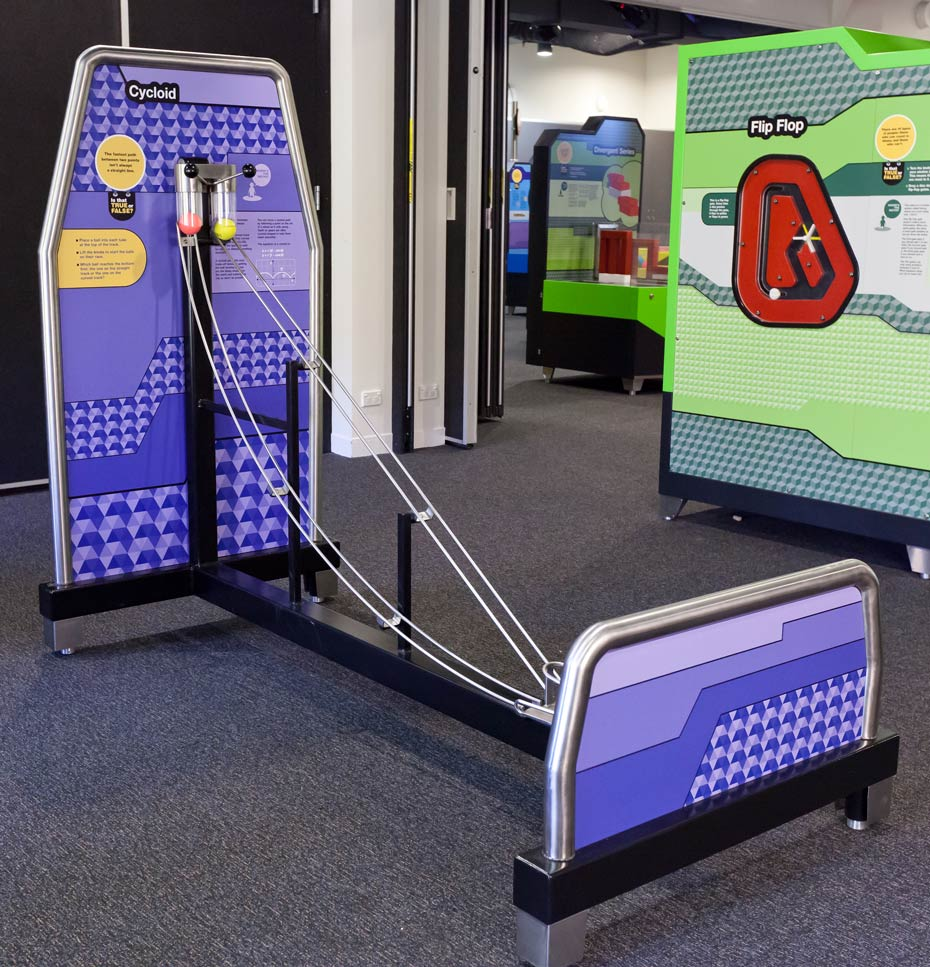 A tall and short purple vertical panels joined together by black steel bars and two metal ball tracks.