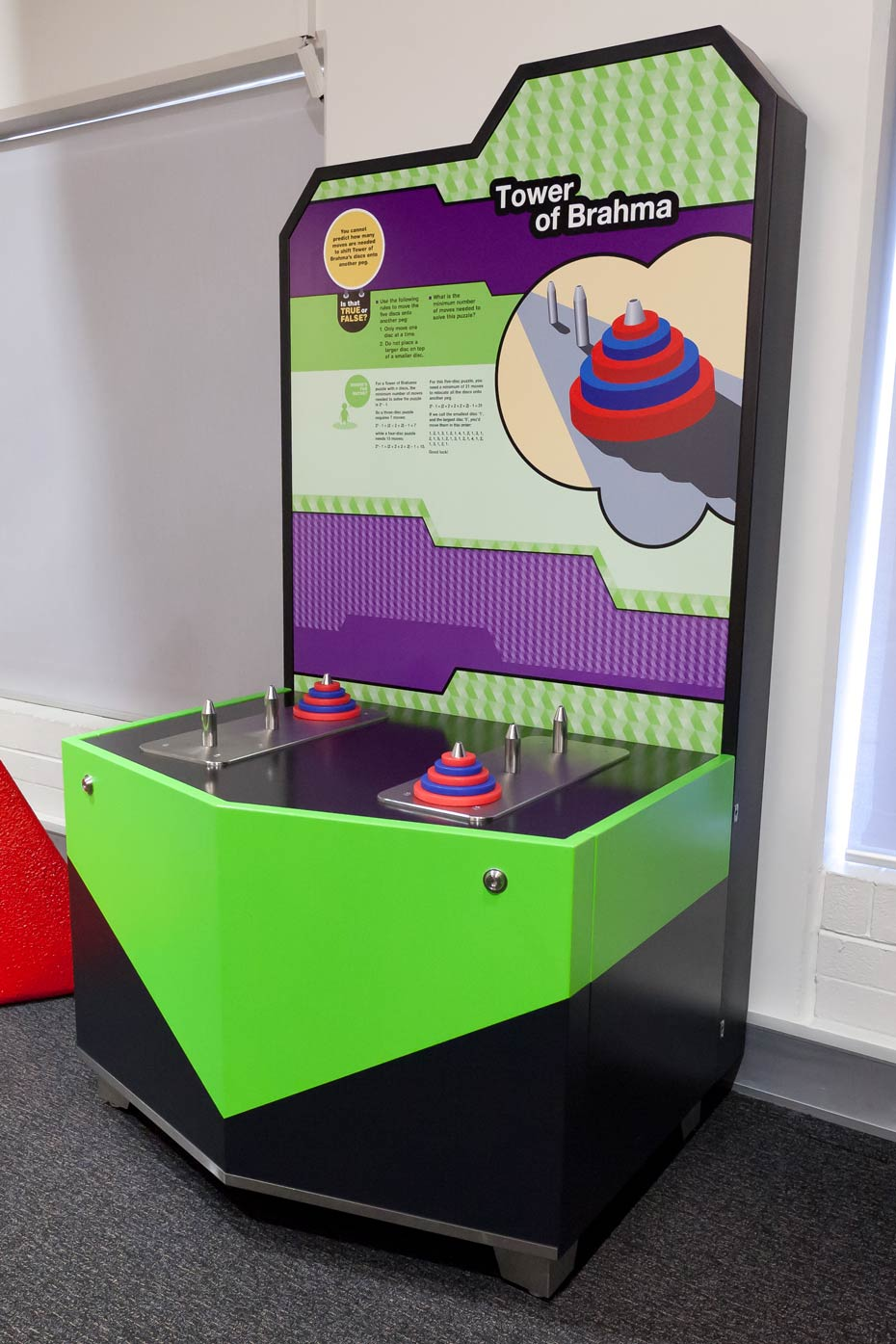 A black, green, white and purple exhibit table with matching information panel.