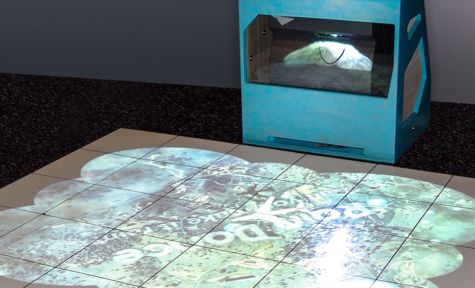 White tiles on the floor have circular light projection onto them, from a blue box at the back of the tiles.