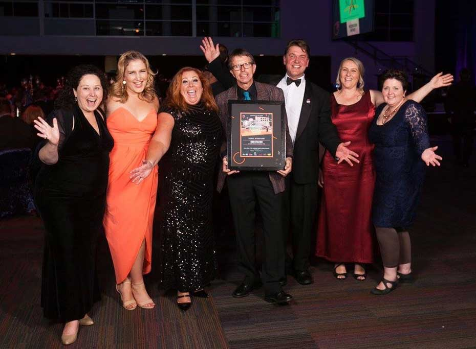 Questacon staff celebrating the tourism award win