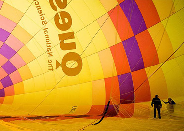 Two people standing in the inside of the Questacon hot air balloon