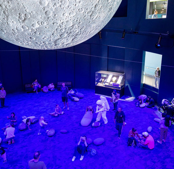 People viewing the Moon exhibit at Questacon