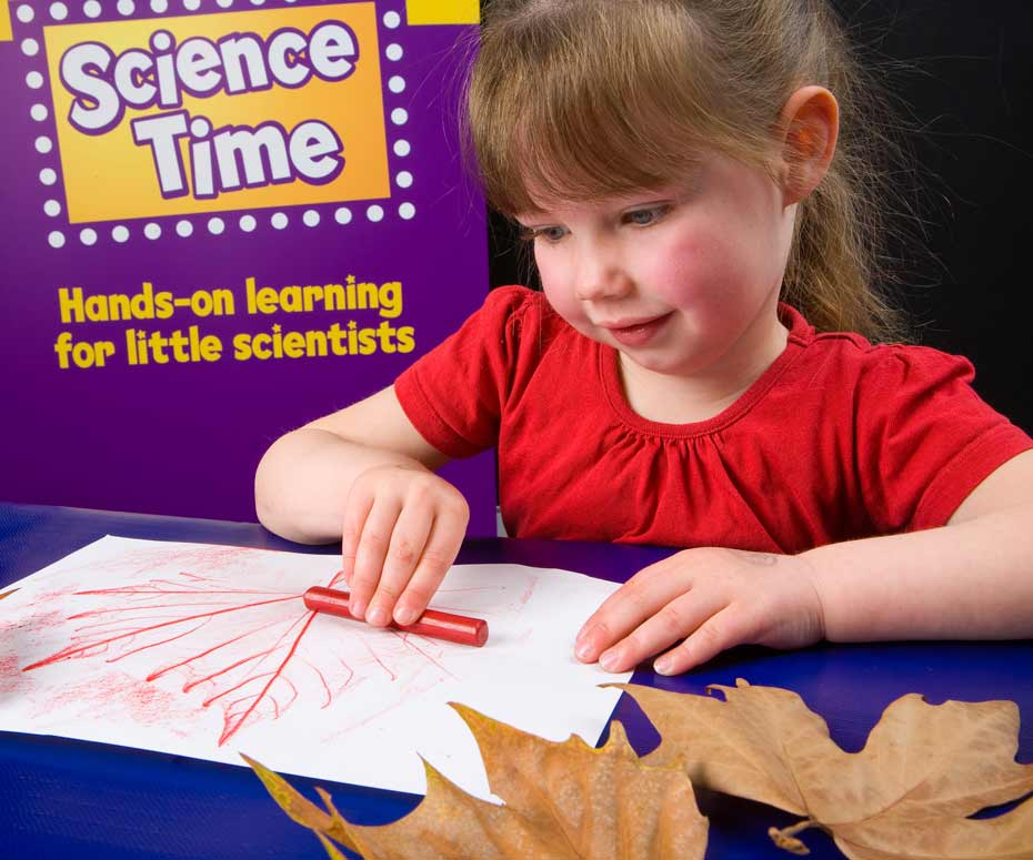 A young girl colouring in a colour-in sheet with a crayon.