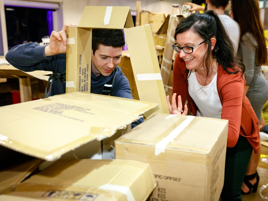 Man and Lady building a box fort and smiling