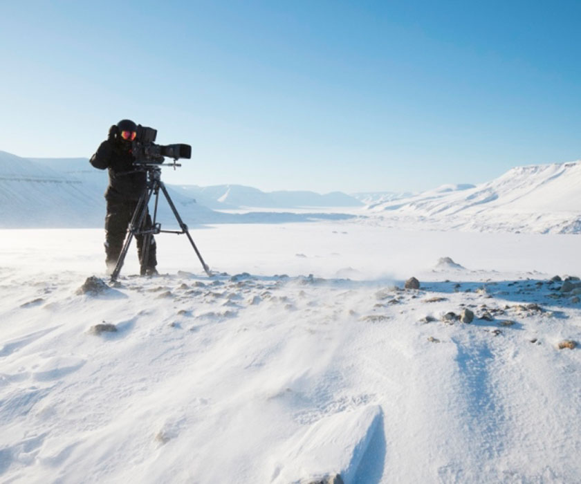 Abraham Joffe taking a photo in a snowfield