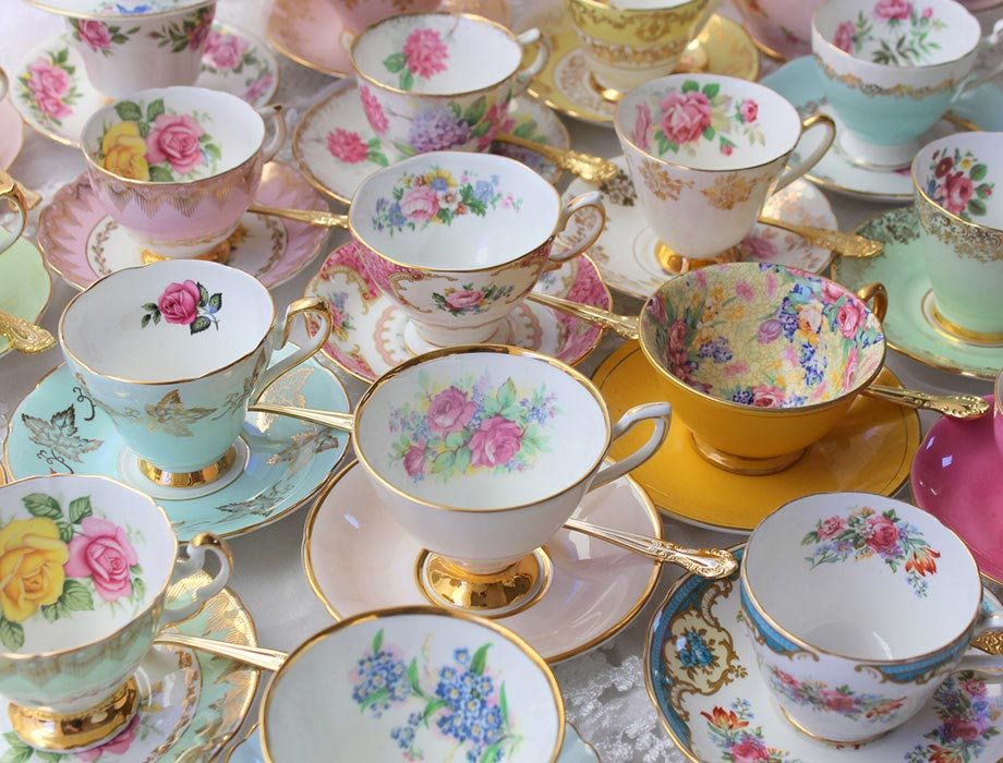A collection of decorative cups and saucers