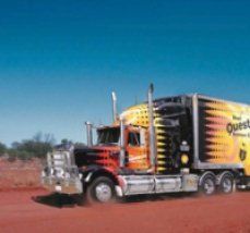 Link to Shell Questacon Science Circus. Icon image of a large truck in the desert.
