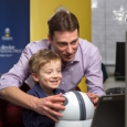David Hobbs teaches a young boy to use Orby