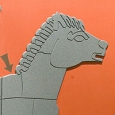 A picture of the head of a grey horse with an arrow pointing to it's neck, set on an orange background.