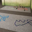 A carpeted area in which there are four abstract rabbit shapes on the carpet.