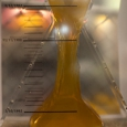 A perspex hour glass with a yellow synthetic rubber slowly flowing from top to bottom.
