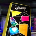 A multi coloured sign with the words 'Optimusic' at the top