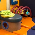 Brightly coloured soft play matts and toys for babies.
