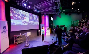 Photo of the Mission Astronautica videoconference, MC and audience in Questacon's Japan Threatre