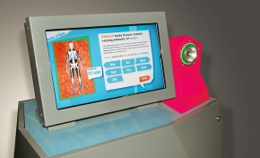 A computer monitor with a skeleton and information being displayed about different body tissues.