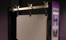 a series of vertical lines held by a horizontal beam
