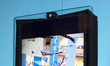 A large monitor showing water ripples interacting with a view of the room.