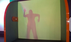 a shadow of a woman displayed on a green screen