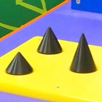 A yellow flat board, with three black cones pointing upwards.