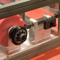 A steel and perspex combination safe with colourful cams visible.