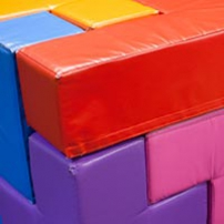 A colourful soft cube shape that has interlocking pieces.