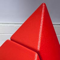 A red triangular shape.