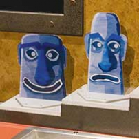 Two blue Easter Island cut out heads.