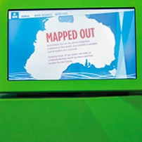 A green monitor screen with a map of Australia and the words 'Mapped Out' displayed.