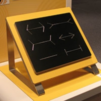 A yellow and black board with metal lines that have arrows, no arrows or perpendicular lines on each line length.