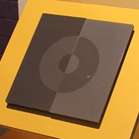 A grey square and circle on top of a yellow background.