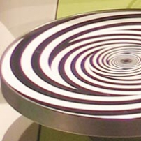 A disc with black and white spiral patterns.