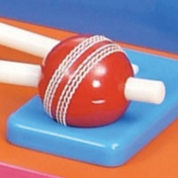 A red cricket ball with a white stick going through it.