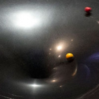 A red and yellow ball rolling down the gravity well