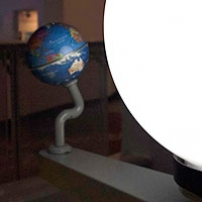 A model earth and sun showing shadows on the earth.