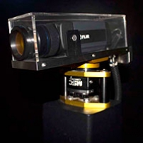 A black thermal camera enclosed in a protective perspex box