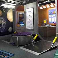 A wall painted with planets and the entrance way to a pretend space ship.