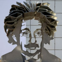 A metal sculpture of Albert Einstein's head and shoulders.