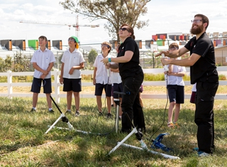 Questacon presenters launch rockets with students