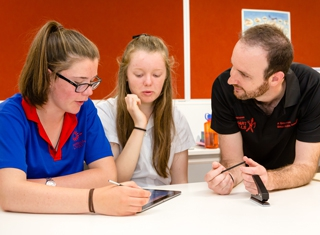 presenter and students using tablet