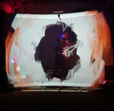Alon Ilsar playing the AirSticks with motion-based visuals in front of him on a screen